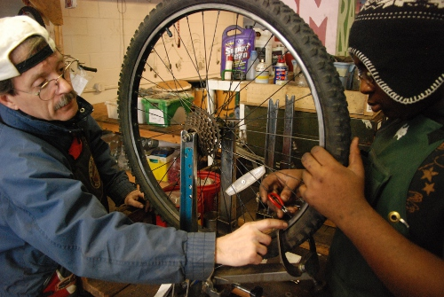 Glenn teaches Savon how to use the truing stand